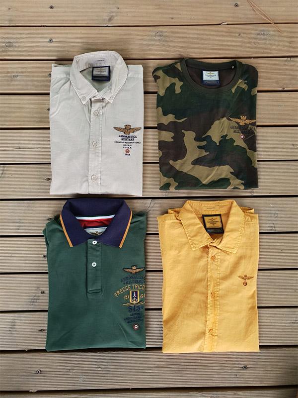 quattro magliette colorate di Aeronautica Militare fotografate dall'alto