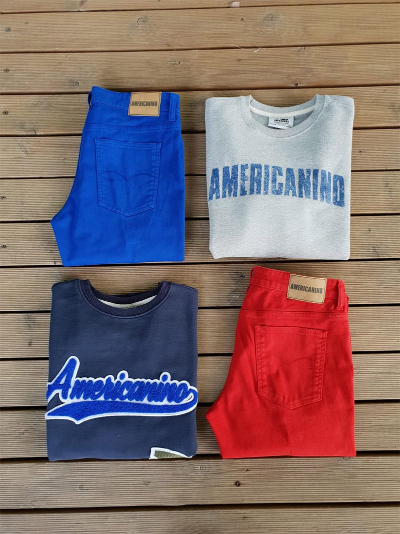 jeans, pantalone rosso e felpa americanino fotografate su sfondo di legno